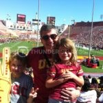 Rodric David with his family at a USC Trojans game